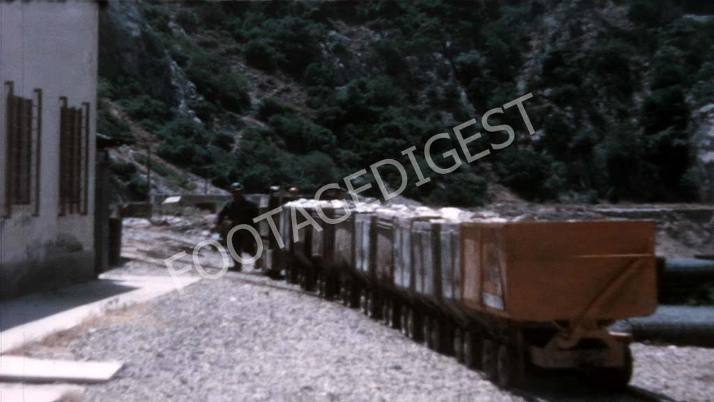 1970s, Italy: Miner working outside a min